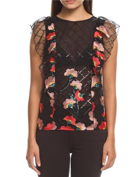 Top con transparencias y flores bordadas